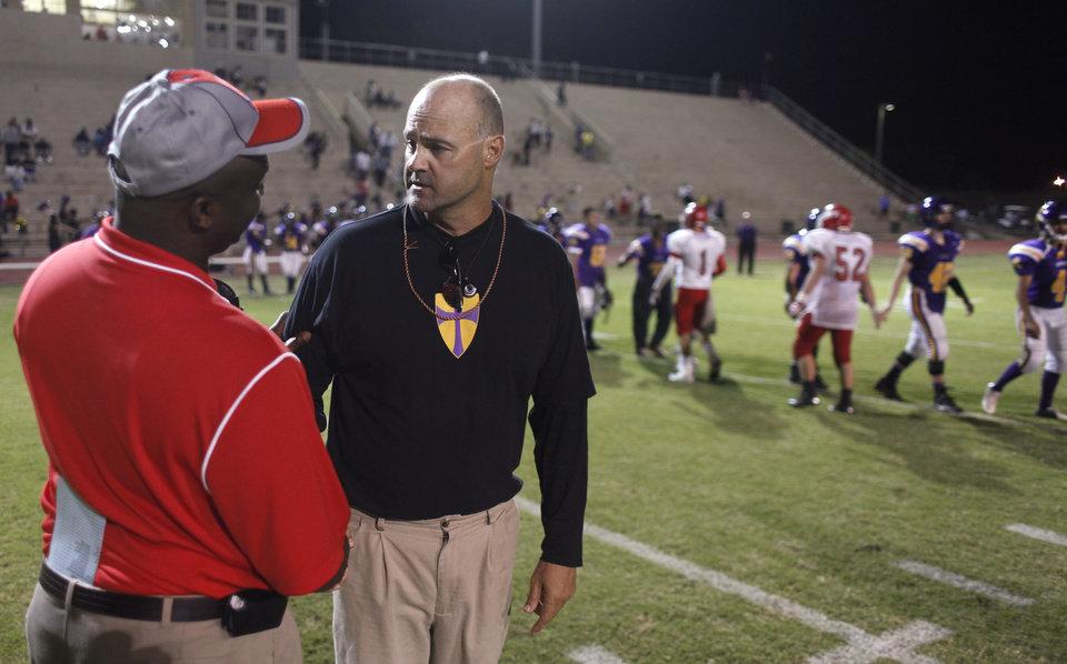 NWC Coach Lloyd Smith shakes hands after the game with Western Heights coach Edward Polly at the Northwest Classen vs. Western Heights high school football game at Taft Stadium Thursday, September 20, 2012. Photo by Doug Hoke, The Oklahoman