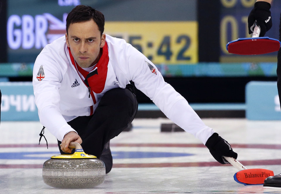 Photo - Britain's skip David Murdoch delivers the stone during the men's curling semifinal game against Sweden at the 2014 Winter Olympics, Wednesday, Feb. 19, 2014, in Sochi, Russia. (AP Photo/Robert F. Bukaty)