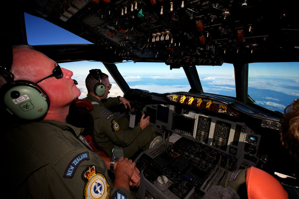 Photo - A Royal New Zealand Air Force P-3 Orion is flown by Flt. Lt Tim McAlevey back, in the search for missing Malaysia Airlines Flight MH370 over the Indian Ocean, Friday, April 11, 2014. Authorities are confident that signals detected deep in the Indian Ocean are from the missing Malaysian jet's black boxes, Australia's Prime Minister Tony Abbott said Friday, raising hopes they are close to solving one of aviation's most perplexing mysteries.   (AP Photo/Richard Wainwright, Pool)