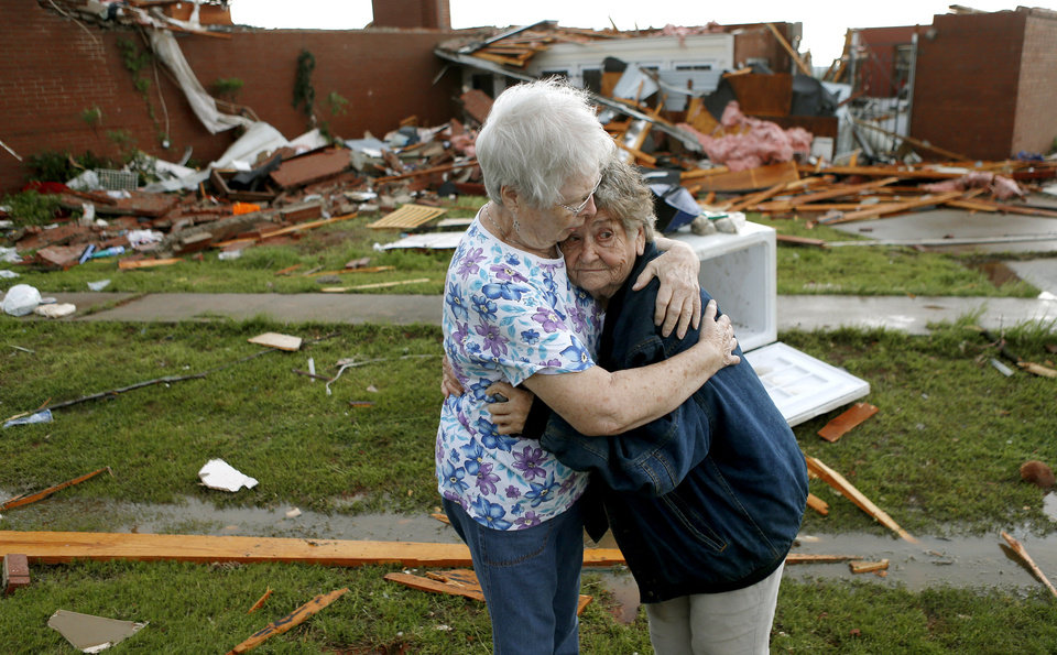 Jerry Dirks, at right, hugs her friend Earlene Langley after a tornado hit Dirks\' home just south of Carney Okla., on Sunday, May 19, 2013. Dirks was in her cellar at the time the tornado hit. Photo by Bryan Terry, The Oklahoman