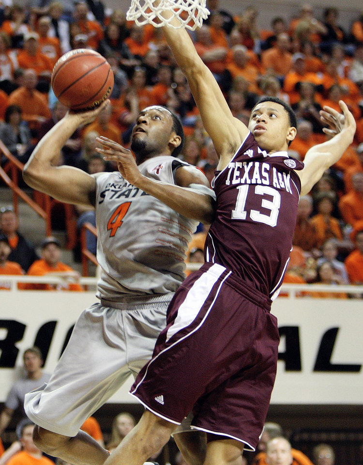 Photo - OSU's Brian Williams (4) takes a shot as Jordan Green (13) defends for Texas A&M in the first half of a men's college basketball game between the Oklahoma State University Cowboys and Texas A&M University Aggies at Gallagher-Iba Arena in Stillwater, Okla., Saturday, Feb. 25, 2012. OSU won, 60-42. Photo by Nate Billings, The Oklahoman
