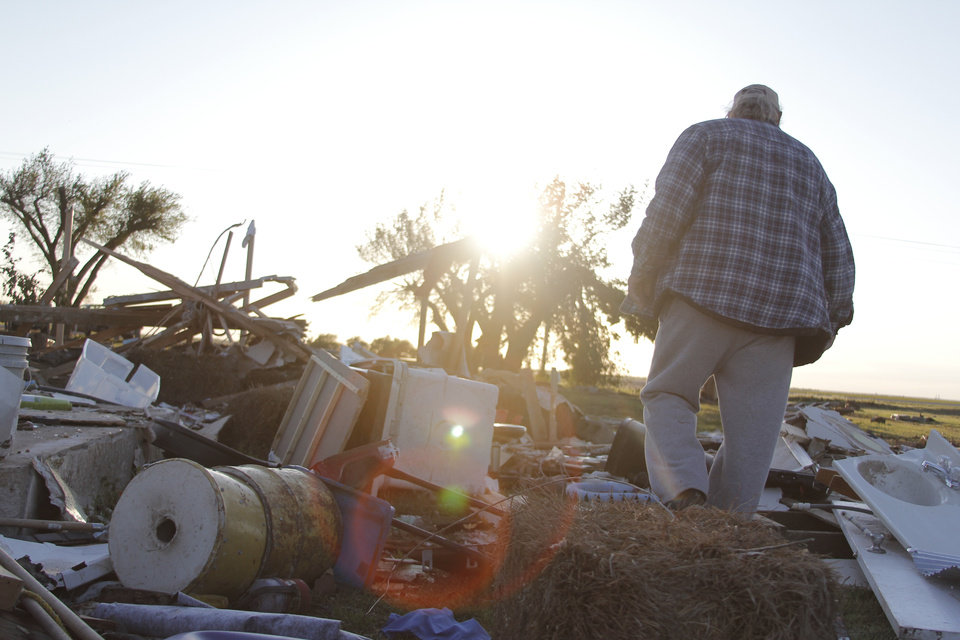 Photo - Rial Allen, who lives in a rural community west of Woodward, stands among the wreckage of what was once his and his wife, Mary's home. Allen lost his son-in-law, Derrin Juul and his granddaughter, Juul's daughter, Rosa Marie, 10, in the tornado. JACLYN COSGROVE/The Oklahoman