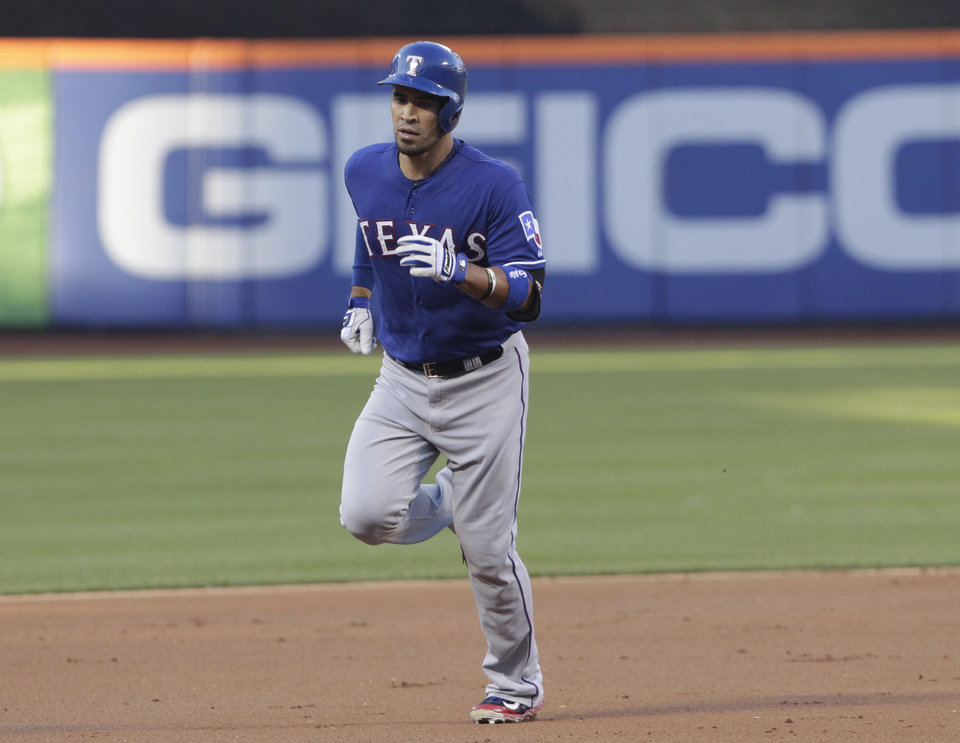 Photo - Texas Rangers' Robinson Chirinos rounds the bases after hitting a three-run home run off New York Mets pitcher Bartolo Colon in the first inning of a baseball game Saturday, July 5, 2014, in New York. (AP Photo/Mark Lennihan)