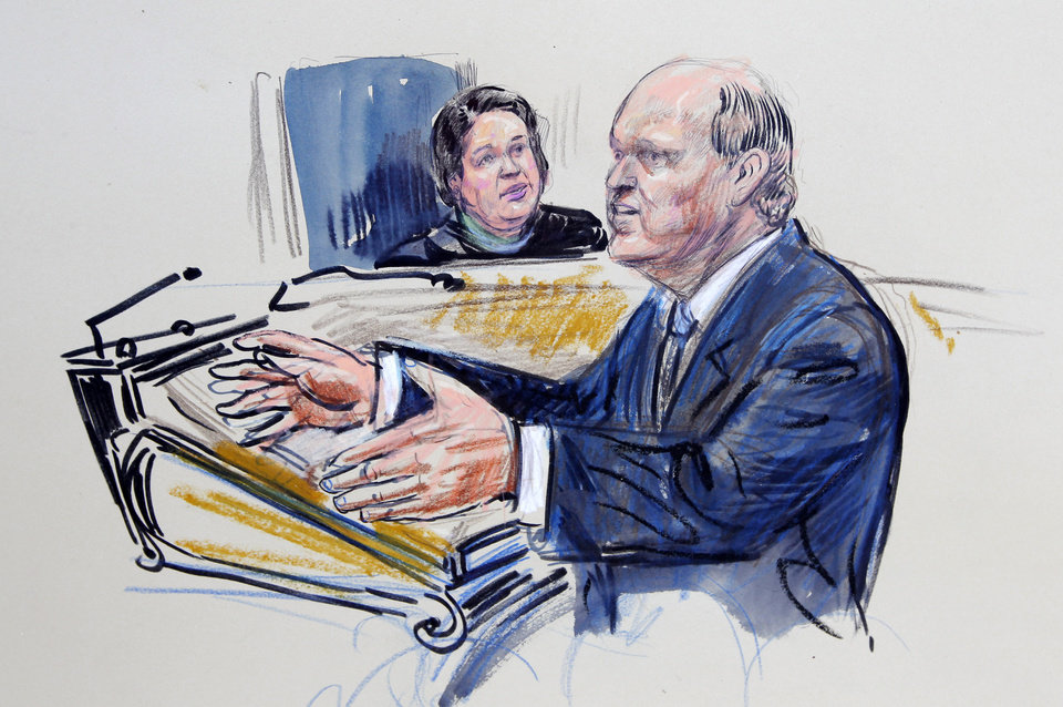 Photo - This artist rendering shows Mike Carvin, counsel for the National Federation of Independent Businesses, speaking before the Supreme Court in Washington, Tuesday, March 27, 2012, as Associate Justice Elena Kagan listens. (AP Photo/Dana Verkouteran) ORG XMIT: DCCD120