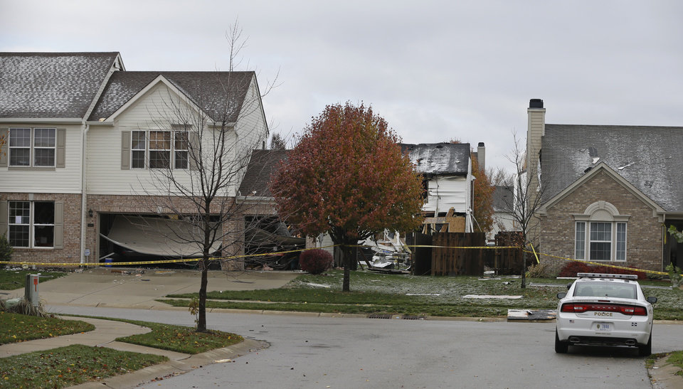 A home that was damage by an explosion is seen Monday, Nov. 12, 2012, in Indianapolis. The explosion happened late Saturday evening and killed two people, destroyed two homes and made dozens more uninhabitable. (AP Photo/Darron Cummings)