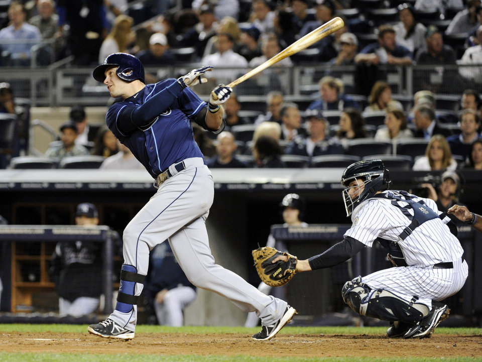 Photo - Tampa Bay Rays' Evan Longoria watches his RBI single in front of New York Yankees catcher J.R. Murphy during the fourth inning of a baseball game Thursday, Sept. 26, 2013, at Yankee Stadium in New York. (AP Photo/Bill Kostroun)
