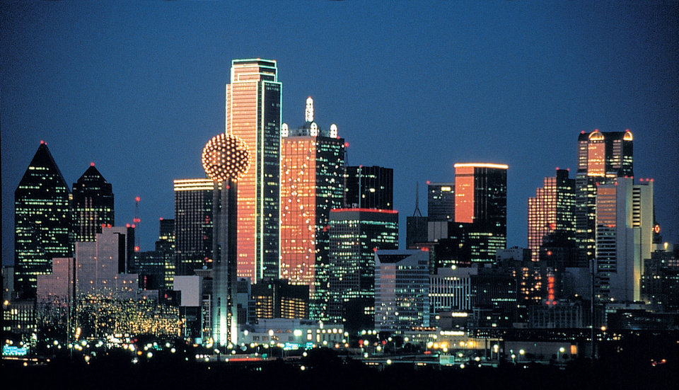 Photo - A dramatic skyline lights up the night. Dallas is the No. 1 visitor destination in Texas.