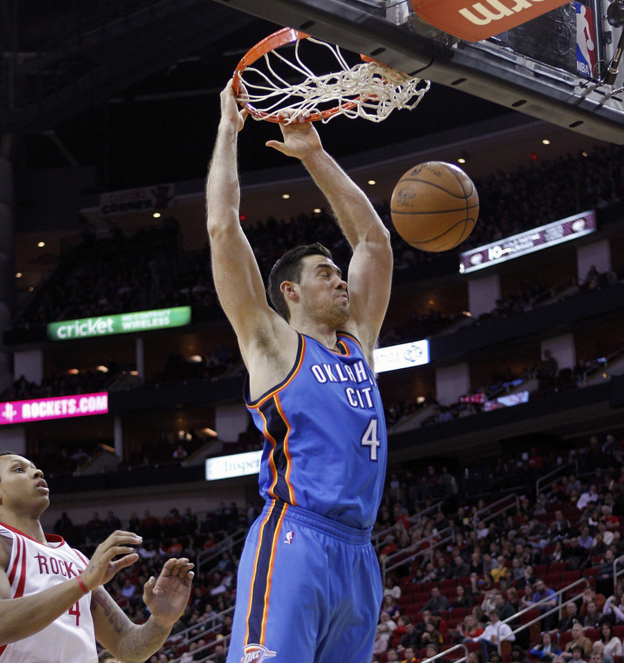 Oklahoma City Thunder forward Nick Collison (4) dunks in front of Houston Rockets forward Greg Smith (4) during the first half of an NBA basketball game, Saturday, Dec. 29, 2012, in Houston. (AP Photo/Bob Levey)