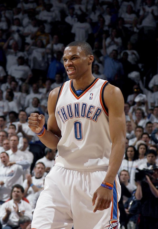 Photo - GAME FOUR / L.A. LAKERS / CELEBRATION: Oklahoma City's Russell Westbrook celebrates during the NBA basketball game between the Los Angeles Lakers and the Oklahoma City Thunder in the first round of the NBA playoffs at the Ford Center in Oklahoma City, Saturday, April 24, 2010. Photo by Sarah Phipps, The Oklahoman ORG XMIT: KOD