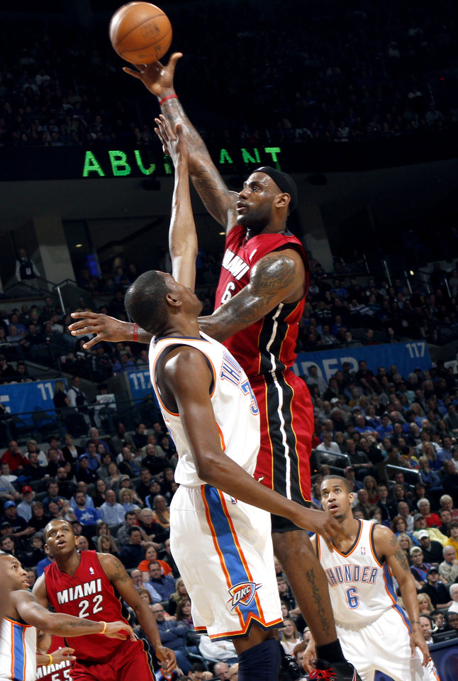 Photo - Oklahoma City's Kevin Durant pressures a shot by Miami's LeBron James during their NBA basketball game at the OKC Arena in Oklahoma City on Thursday, Jan. 30, 2011. Photo by John Clanton, The Oklahoman