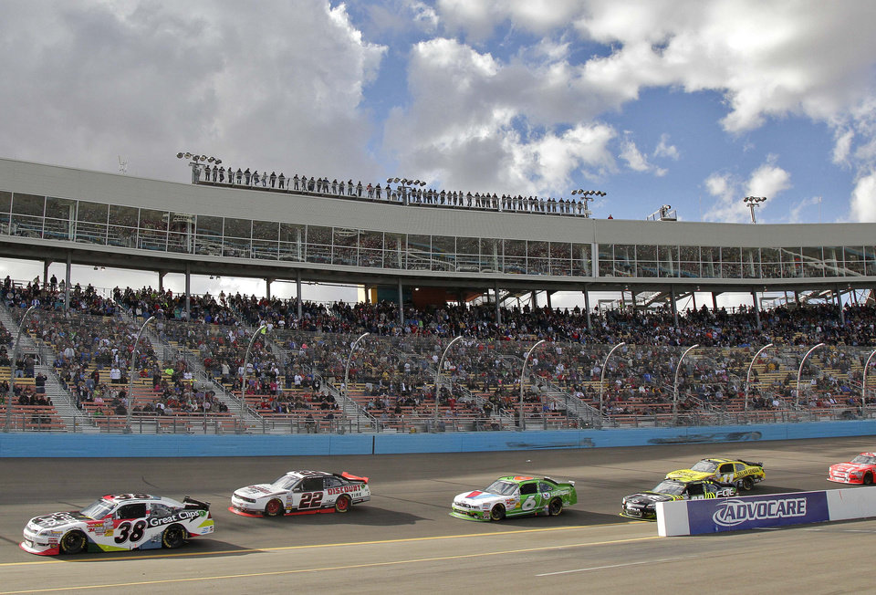 Drivers round Turn 1 on the opening lap of the NASCAR Nationwide Series auto race, Saturday, Nov. 10, 2012, at Phoenix International Raceway in Avondale, Ariz. (AP Photo/Matt York)
