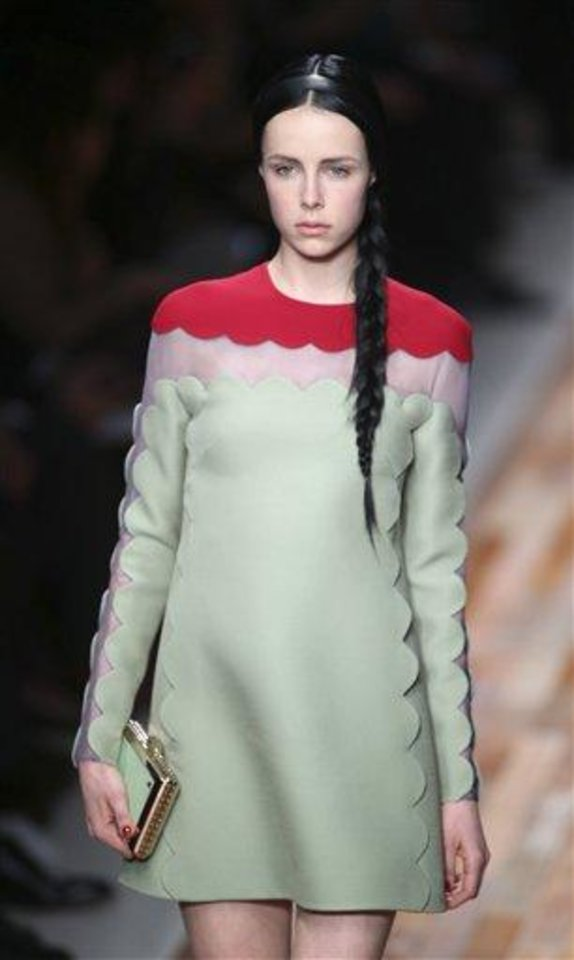 A model wears a creation by fashion designers Maria Grazia Chiuri and Pier Paolo Piccioli for Valentino\'s Ready to Wear\'s Fall-Winter 2013-2014 fashion collection, presented, Tuesday, March 5, 2013 in Paris. (AP Photo/Thibault Camus)