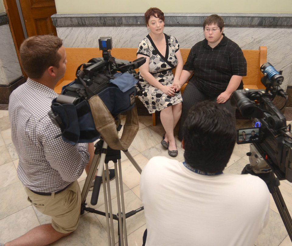 Photo - Donnica Barrett and Nikki Barrett are interviewed just before their wedding ceremony in judge Chris Newton's courtroom in the Vigo County, Ind., courthouse Wednesday evening June 25, 2014. Nikki Barrett changed her last name to match Donnica's years ago when it looked like same-sex marriages would never be legal in Indiana.(AP Photo/Tribune-Star, Jim Avelis)