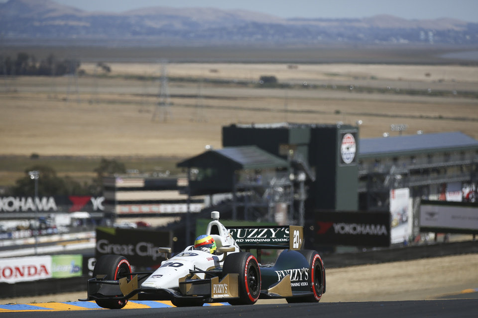 Photo - Mike Conway takes a turn during the GoPro Grand Prix of Sonoma IndyCar series auto race, Sunday, Aug. 24, 2014, in Sonoma, Calif. (AP Photo/Elijah Nouvelage)