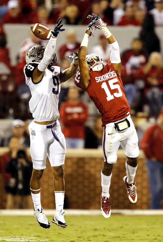 Oklahoma's Zack Sanchez (15) breaks up a pass intended for TCU's Josh Doctson (9) during the second half of a college football game between the University of Oklahoma Sooners (OU) and the TCU Horned Frogs at Gaylord Family-Oklahoma Memorial Stadium in Norman, Okla., on Saturday, Oct. 5, 2013. Photo by Steve Sisney, The Oklahoman