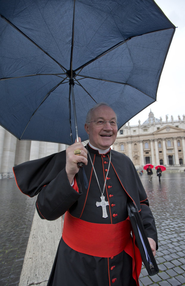 Canadian Cardinal Marc Ouellet holds on to his umbrella and his skull cap on a rainy windy day as he walks in St. Peter's Square after attending a cardinals' meeting, at the Vatican, Wednesday, March 6, 2013. Cardinals are meeting to discuss the problems of the church and to get to know one another because there is no clear front-runner in the election of the new pope. (AP Photo/Andrew Medichini)