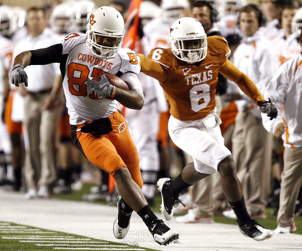 Photo - Oklahoma State's Tracy Moore (87) is brought down by Texas' Christian Scott (6)during the college football game between the Oklahoma State University Cowboys (OSU) and the University of Texas Longhorns (UT) at Darrell K Royal-Texas Memorial Stadium in Austin, Texas, Saturday, November 13, 2010. Photo by Sarah Phipps, The Oklahoman