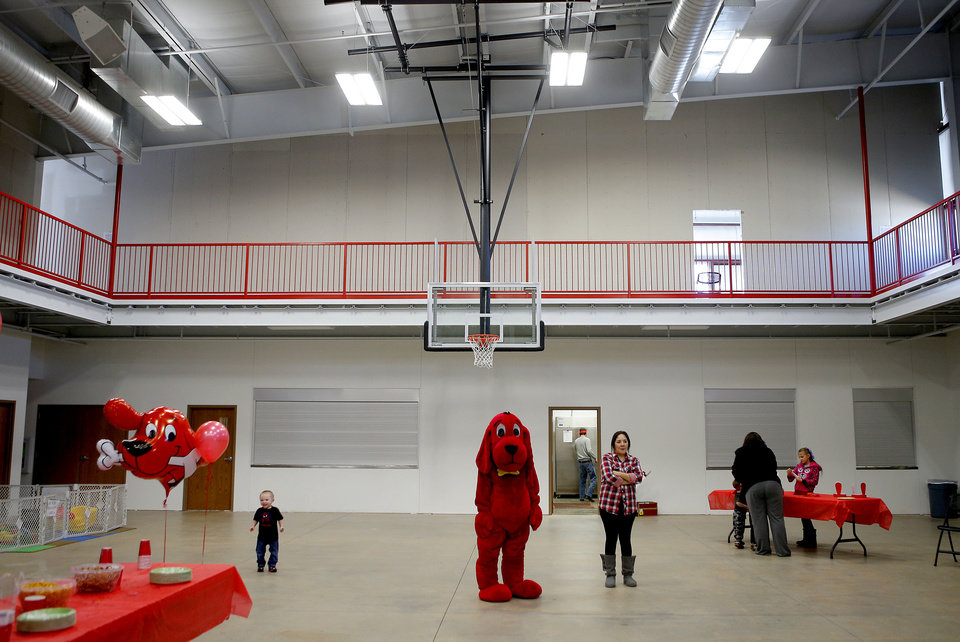 Photo - Cilfford stands inside the Christian Life Center at First United Methodist Church in Moore during a birthday party for Clifford the Big Red Dog. Photo by Bryan Terry, The Oklahoman  BRYAN TERRY - THE OKLAHOMAN