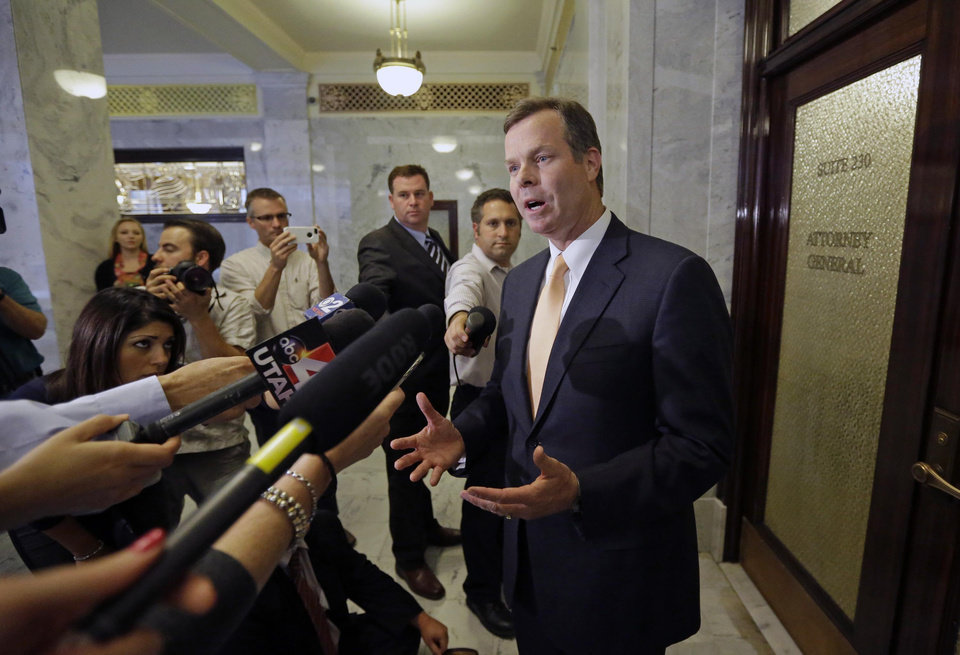 Photo - FILE - In this June 19, 2013, file photo, Utah Attorney General John Swallow addresses reporters outside his office following a three-hour caucus meeting at the Utah State Capitol, in Salt Lake City. The cost of the ongoing Utah House investigation of the state's attorney general is nearing $1.5 million. The Salt Lake Tribune reports Republican Rep. Jim Dunnigan said Wednesday that investigators have talked with 140 witnesses and issued 15 subpoenas during the first three months of the inquiry into a series of allegations against John Swallow. He's accused of attempted bribery and accepting gifts and favors among other accusations. Swallow denies any wrongdoing.  (AP Photo/Rick Bowmer, File)