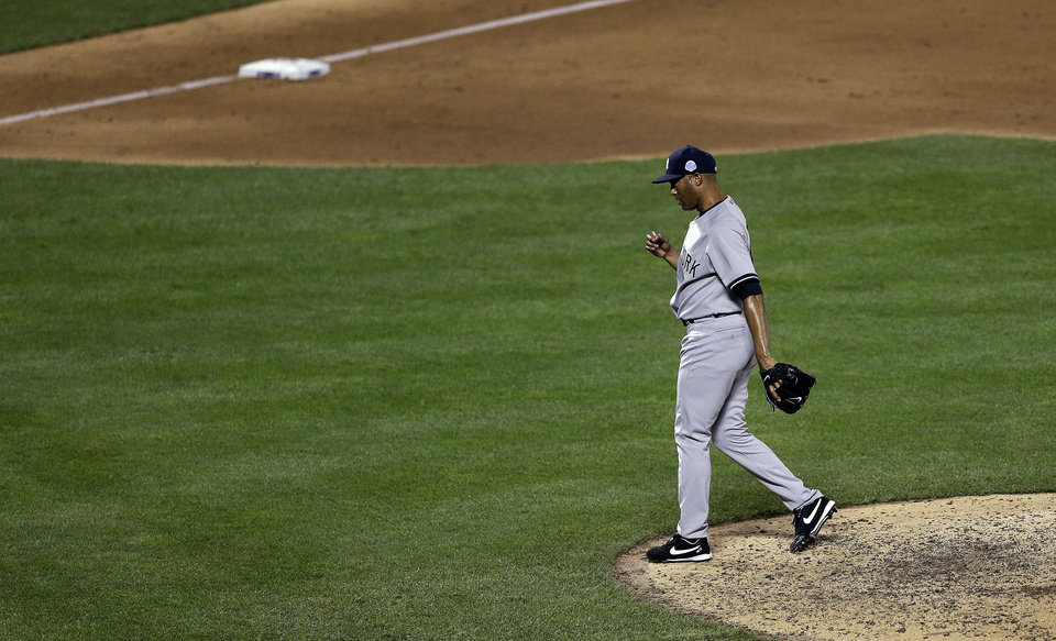 Photo - American League's Mariano Rivera, of the New York Yankees, reacts after pitching during the eighth inning of the MLB All-Star baseball game, on Tuesday, July 16, 2013, in New York. (AP Photo/Julio Cortez)