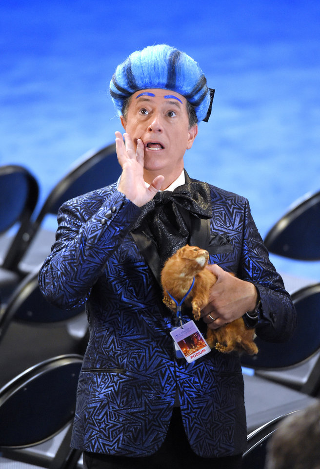"Photo - Comedian Stephen Colbert yells ""Lock her up! Lock her up!"" as he records a comedy routine as preparations are underway ahead of the Democratic National Convention, Sunday, July 24, 2016, in Philadelphia. (AP Photo/Mark J. Terrill)"