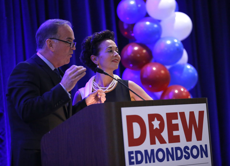 Photo - Cathy and Sean Cummings speak during a watch party for Drew Edmondson and the democratic party at the Embassy Suites  in Oklahoma City, Tuesday, Nov. 6, 2018. Photo by Sarah Phipps, The Oklahoman
