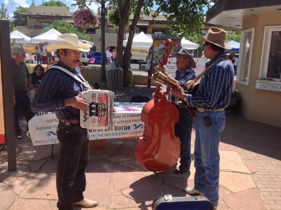 Photo - Local musicians entertain the visitors during the farmer's market. Photo by Carla Meadows