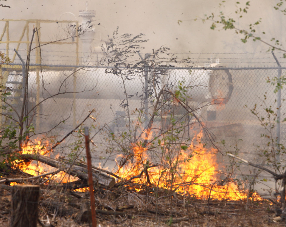 Photo - A large wildfire burns trees and brush near a natural gas pipeline at the intersection of Air Depot and Wilshire in Oklahoma City, OK, Tuesday, Aug. 30, 2011. By Paul Hellstern, The Oklahoman
