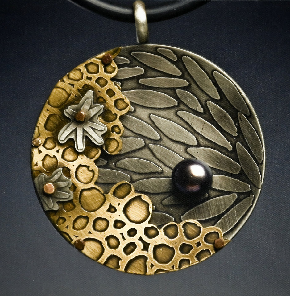 Photo -  Jewelry by artist Suzette Nesbitt, of Branson, Mo., on display during the Oklahoma City Festival of the Arts in Oklahoma City, Okla. on Tuesday, April 21, 2015. Photo by Chris Landsberger, The Oklahoman   CHRIS LANDSBERGER -  CHRIS LANDSBERGER