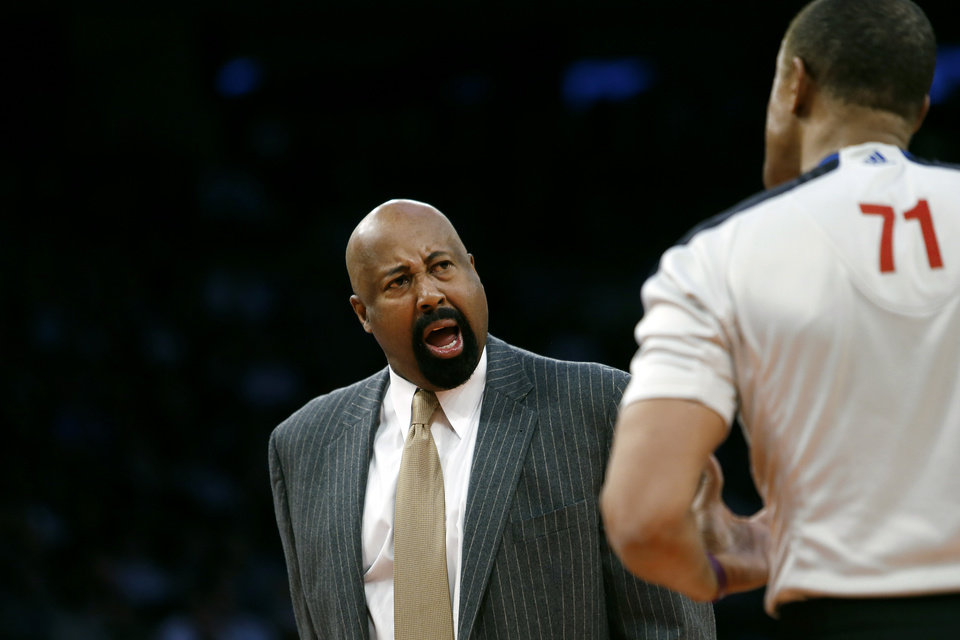 Photo - New York Knicks coach Mike Woodson argues with an official during the second half of an NBA basketball game against the Dallas Mavericks, Monday, Feb. 24, 2014, in New York. Dallas won 110-108. (AP Photo/Jason DeCrow)