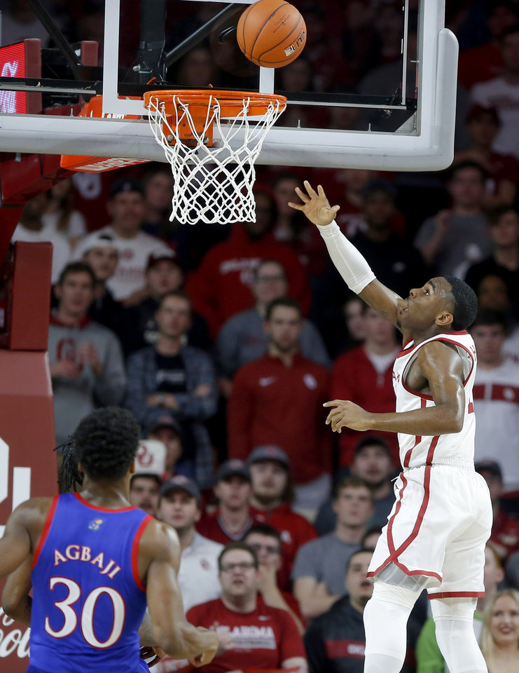 Photo - Oklahoma's De'Vion Harmon (11) makes a basket beside Kansas' Ochai Agbaji (30) during an NCAA college basketball game between the University of Oklahoma Sooners (OU) and the University of Kansas Jayhawks at Lloyd Noble Center in Norman, Okla., Tuesday, Jan. 14, 2020. [Bryan Terry/The Oklahoman]