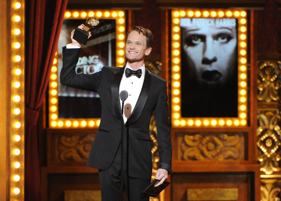 Photo - Neil Patrick Harris accepts the award for best performance by an actor in a leading role in a musical for