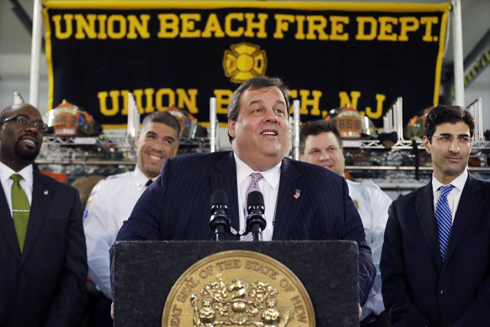 Photo - New Jersey Gov. Chris Christie smiles Tuesday, Feb. 5, 2013, in Union Beach, N.J., as he is playfully asked about his weight. Christie has termed his plumpness