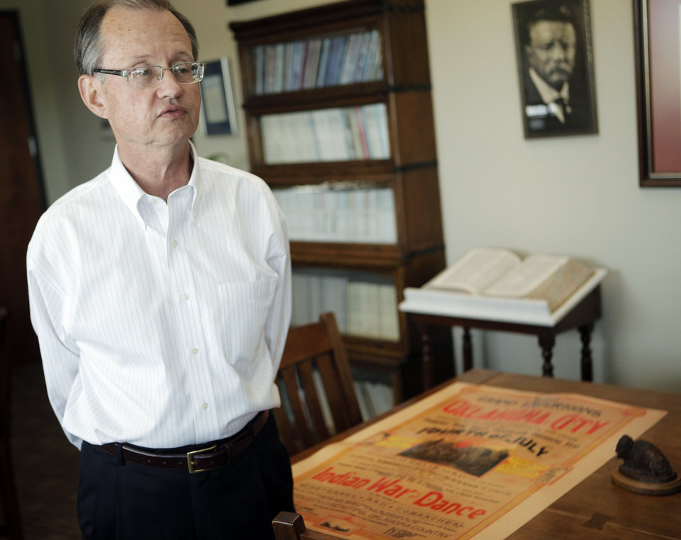 Photo - Oklahoma Historical Society Executive Director Bob Blackburn stands near a replica copy of the recently unearthed poster of the 1889 4th of July celebrations in Oklahoma City on July 2, 2013. The original poster was preserved in a time capsule in 1913 and will go on display Thursday at an exhibit at the Oklahoma Historical Society. Photo by KT KING, The Oklahoman  KT King - KT KING