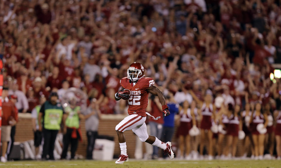 Photo - OU's Roy Finch (22) returns the second half kickoff against KU during the college football game between the University of Oklahoma Sooners (OU) and the University of Kansas Jayhawks (KU) at Gaylord Family-Oklahoma Memorial Stadium on Saturday, Oct. 20th, 2012, in Norman, Okla. Photo by Chris Landsberger, The Oklahoman