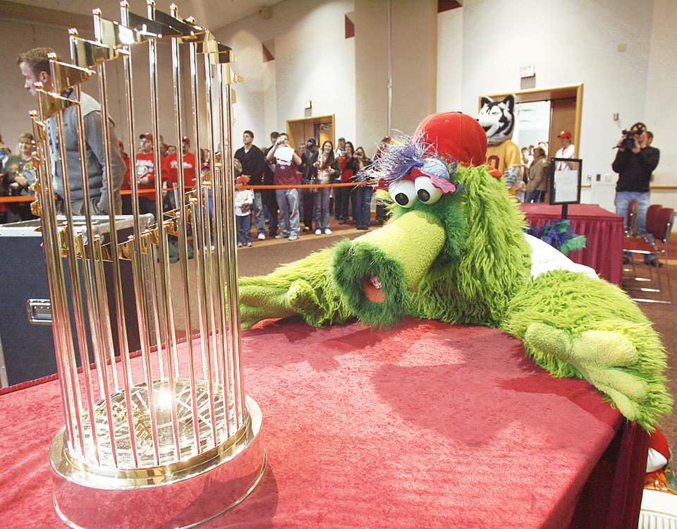 Photo - Phillie Phanatic The Phillies' legendary mascot got to spend some quality time with the World Series trophy in 2008.  AP Photo