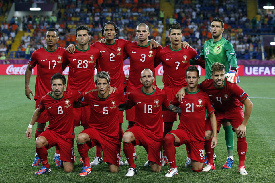 Photo - FILE- In this June 13, 2012 file photo, Portugal soccer team poses prior to the start the Euro 2012 soccer championship Group B match between Portugal and the Netherlands in Kharkiv, Ukraine. Background from left: Nani, Helder Postiga,  Bruno Alves, Pepe, Cristiano Ronaldo and Rui Patricio. Foreground from left: Joao Moutinho, Fabio Coentrao, Raul Meireles, Joao Pereira and Miguel Veloso. (AP Photo/Armando Franca, File) - SEE FURTHER WORLD CUP CONTENT AT APIMAGES.COM