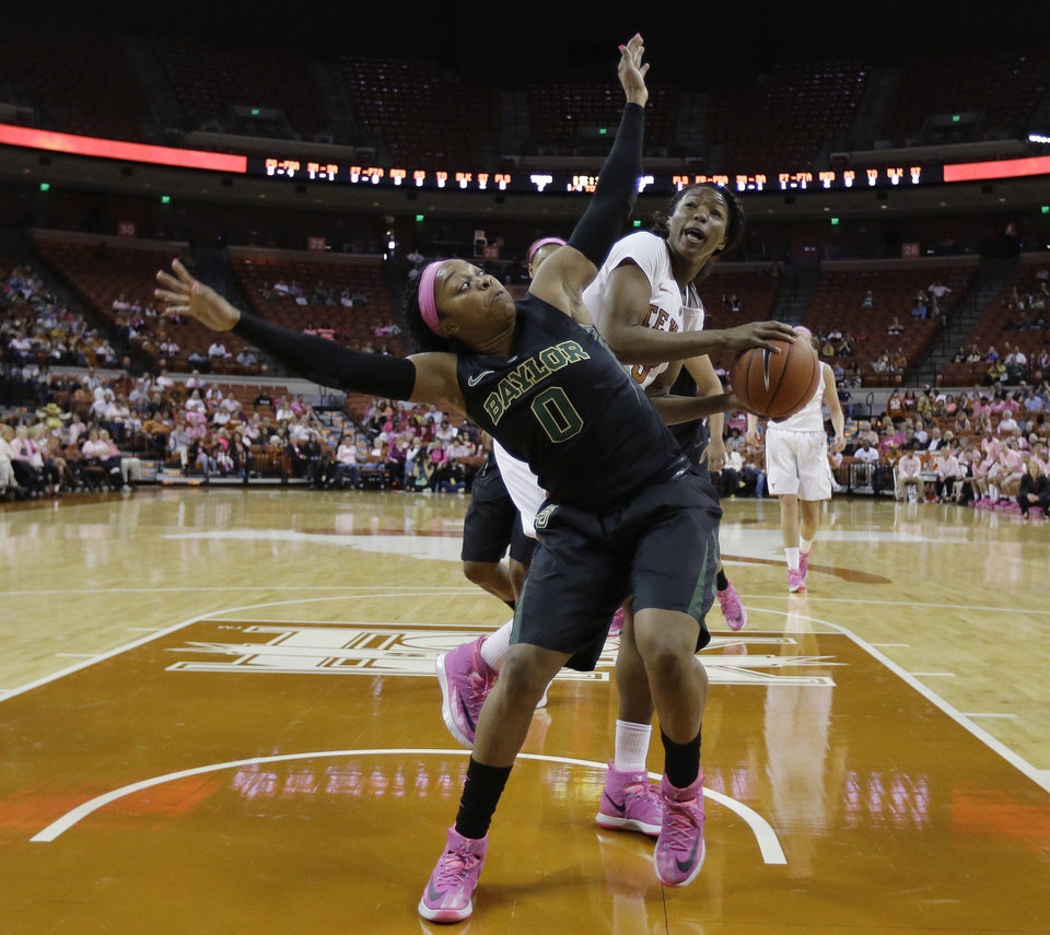 Photo - Baylor's Odyssey Sims (0) blocks out Texas' Nneka Enemkpali who tries to shoot during the first half of an NCAA college basketball game on Sunday, Feb. 16, 2014, in Austin, Texas. (AP Photo/Eric Gay)