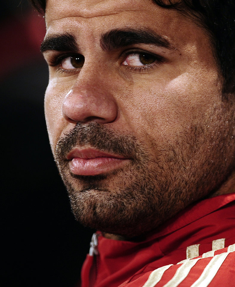 Photo - Spain's Diego Costa looks on during a press conference at the Atletico Paranaense training center in Curitiba, Brazil, Tuesday, June 10, 2014. Spain will play in group B of the Brazil 2014 soccer World Cup. (AP Photo/Manu Fernandez)