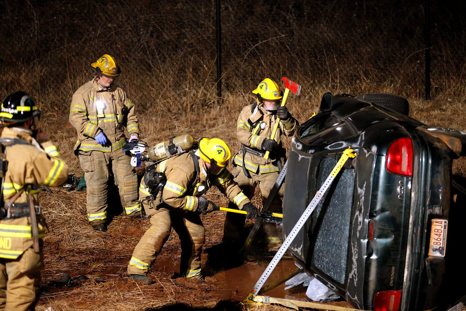 Edmond firefighters train after dark, responding to a simulated vehicle accident. Photo by Sarah Phipps, The Oklahoman <strong>SARAH PHIPPS - SARAH PHIPPS</strong>