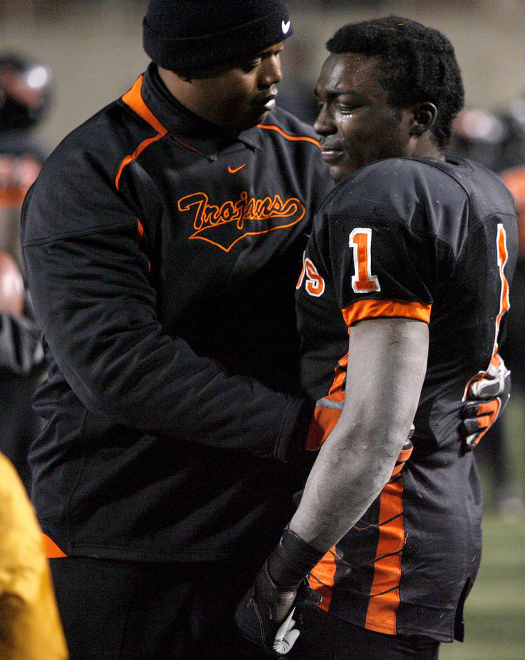 Douglass coach Willis Alexander talks with Quinton Neil at the end of the Class 4A high school football state championship game betweeen Star Spencer Douglass at Boone Pickens Stadium in Stillwater, Okla., Saturday, December 5, 2009. Photo by Bryan Terry, The Oklahoman