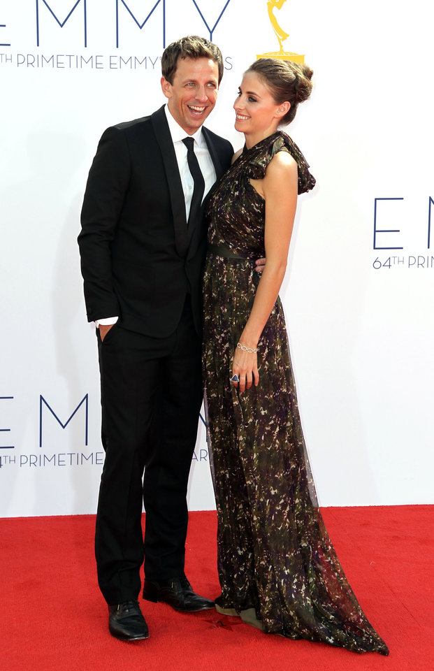Photo -   Seth Meyers, left, and Alexi Ashe arrive at the 64th Primetime Emmy Awards at the Nokia Theatre on Sunday, Sept. 23, 2012, in Los Angeles. (Photo by Matt Sayles/Invision/AP)