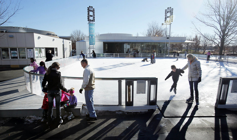 Visitors enjoy ice skating at the Myriad Gardens on Thursday in Oklahoma City.