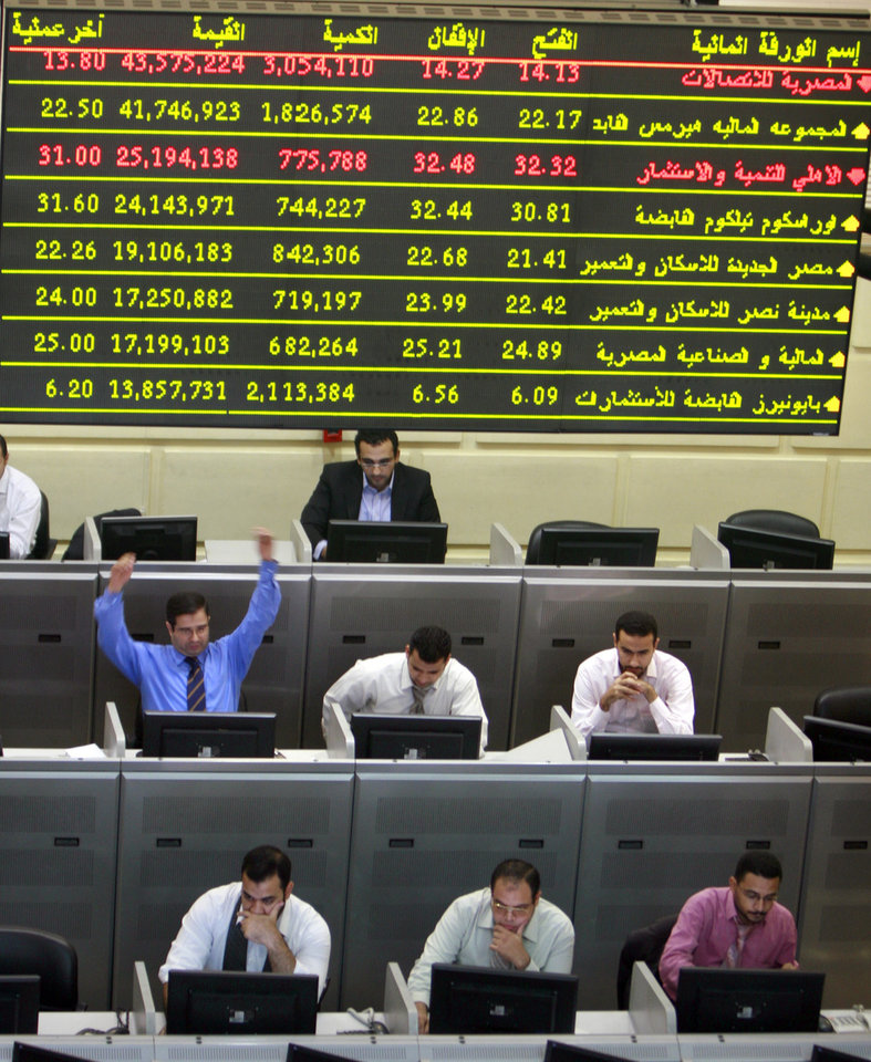 FILE - In this Wednesday, Oct. 29, 2008 file photo, an Egyptian broker gestures during a session at the Egyptian stock market in Cairo, Egypt. Egypt's benchmark stock index on Sunday plunged by more than 9.5 percent in the first trading session since the country's Islamist president issued decrees to assume sweeping new powers, while police in central Cairo fired tear gas at protesters who accuse the Egyptian leader of a blatant power grab. (AP Photo/Amr Nabil, File)