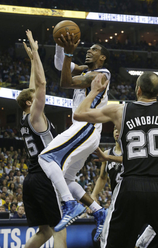 Memphis Grizzlies\' Mike Conley, center, drives to the basket as San Antonio Spurs guard Manu Ginobili (20) and forward Matt Bonner (15) defend during the first half in Game 3 of the Western Conference finals NBA basketball playoff series in Memphis, Tenn., Saturday, May 25, 2013. (AP Photo/Danny Johnston)