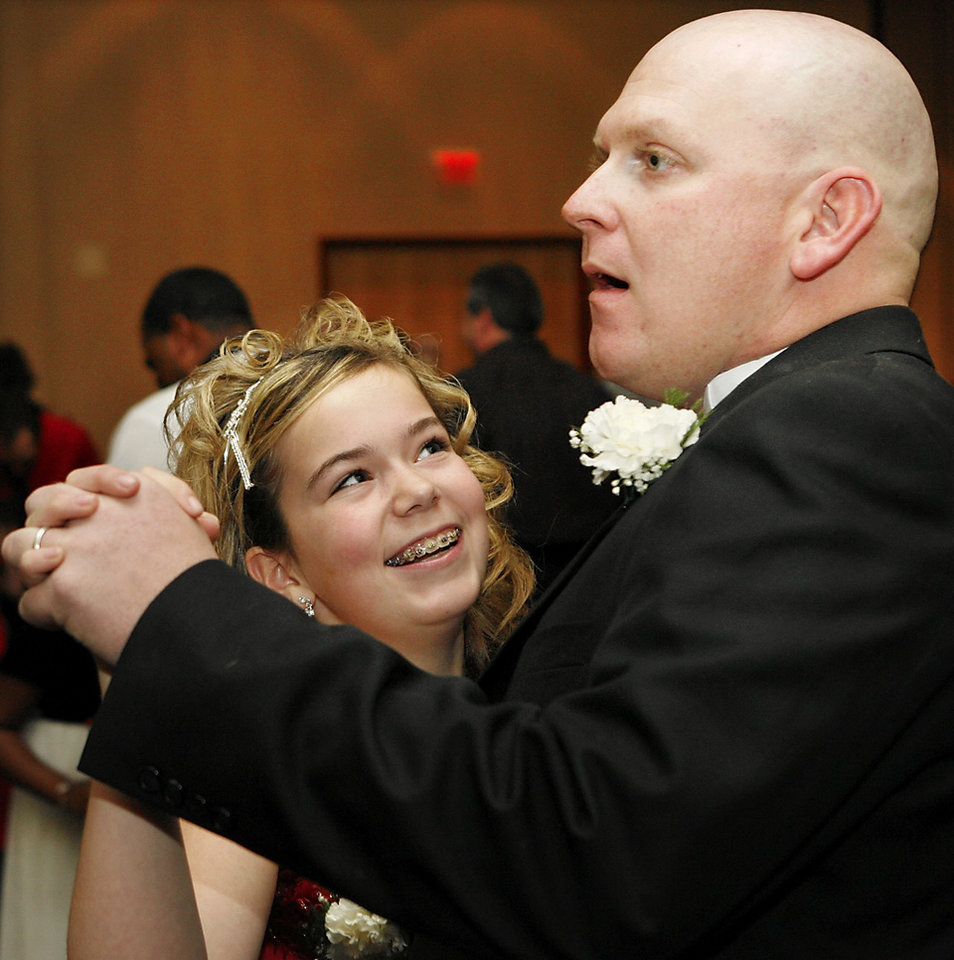 Photo - Shelby Neal, 11, enjoys a dance with her dad, William Lewis of Choctaw, at the Daddy-Daughter Dance at the Reed Center in Midwest City Saturday night, Feb. 7, 2009. The annual event is hosted by the Midwest City Parks and Recreation Department.   BY JIM BECKEL, THE OKLAHOMAN