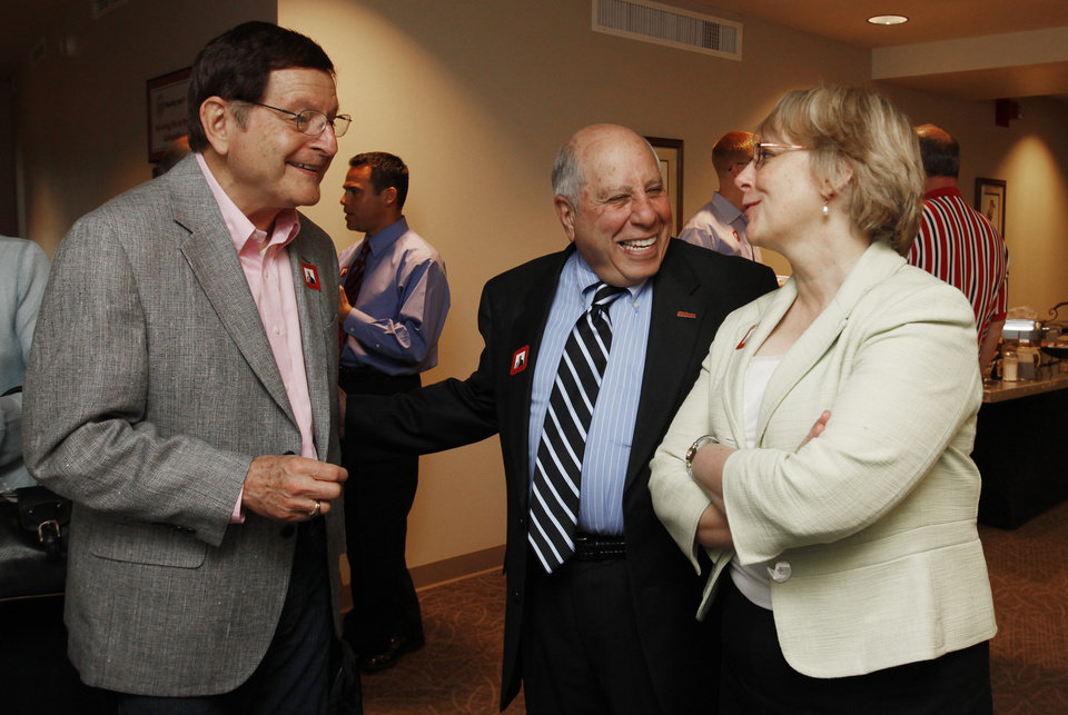 Paul D. Massad (middle) visits with L to r - Frank Gilson and Robyn Tower during a breakfast Thurs. April 15, 2010 to honor Massad for 50 years of service to OU. Photo by Jaconna Aguirre, The Oklahoman.