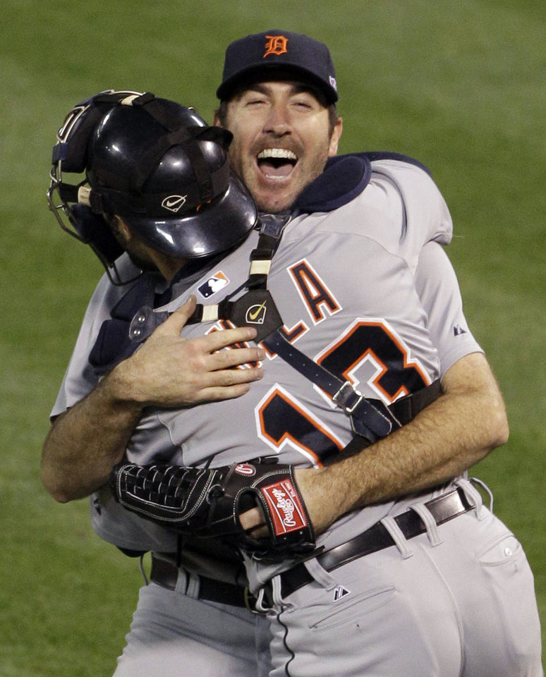 Photo -   Detroit Tigers starting pitcher Justin Verlander hugs catcher Alex Avila after the Tigers beat the Oakland Athletics 6-0 in Game 5 of an American League division baseball series in Oakland, Calif., Thursday, Oct. 11, 2012. (AP Photo/Eric Risberg)