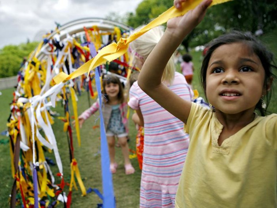 Photo -  Sonya Thapa, age 5, of Norman, plays with other children at the Creation Station during the final day of the Festival of the Arts in downtown Oklahoma City on Saturday, April 26, 2009. Photo by John Clanton ORG XMIT: KOD