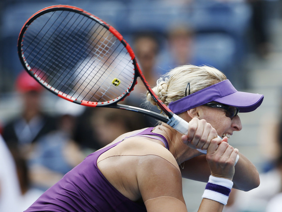 Photo - Mirjana Lucic-Baroni, of Croatia, follows through on a shot against Sara Errani, of Italy, during the third round of the 2014 U.S. Open tennis tournament, Sunday, Aug. 31, 2014, in New York. (AP Photo/Kathy Willens)